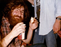 Deadhead Bobby enjoying a bagel and drink