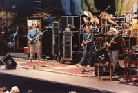 Grateful Dead, ca. 1988: Phil Lesh, Bob Weir, Bill Kreutzmann, Jerry Garcia, and Mickey Hart (obscured)