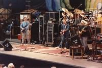 Grateful Dead, ca. 1988: Phil Lesh, Bob Weir, Bill Kreutzmann, Jerry Garcia, and Mickey Hart (obscured)