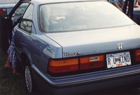 "Deadhead vehicle with ""R U KIND"" Illinois license plate, ca. 1990"