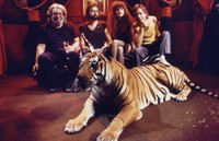 """Hell in a Bucket"" video shoot: Jerry Garcia, Len Dell'Amico, unidentified actress, and Bob Weir, with tiger"