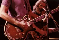 Grateful Dead: Jerry Garcia, with Bob Weir's guitar in foreground