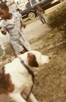 Unidentified photograph, with a dog and two children in the background, ca. 1990