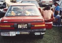 "Deadhead vehicle with ""J STRAW"" Kansas license plate, ca. 1990"