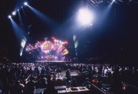 Grateful Dead, ca. 1994: stage lighting, unidentified crew members, and Deadheads