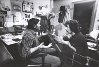 Bill Graham and Sam Cutler in Bill's office, with unidentified others, ca. 1970