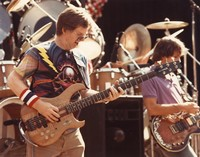 Grateful Dead: Phil Lesh, with Bob Weir in the background