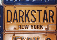 "Grateful Dead merchandise: New York license plate embossed with ""DARKSTAR"", that was part of a display at an unknown location"