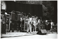 Grateful Dead, ca. 1980s: Phil Lesh, Bob Weir, Jerry Garcia, and Brent Mydland, with Bill Kreutzmann and Mickey Hart obscured