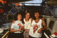Unidentified crew members with laminates, summer 1991