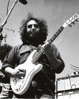 Jerry Garcia, with his Travis Bean guitar, at a benefit for Greenpeace