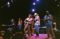"Bruce Hornsby, Sherri Jackson, Rob Wasserman, Bob Weir, Arlo Guthrie, and Michael Falzarano performing ""Ripple"" during the acoustic jam"