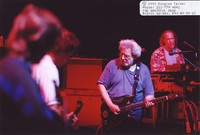Grateful Dead: Jerry Garcia, with Vince Welnick in the background, and Phil Lesh and Bob Weir in the foreground