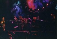 Grateful Dead performing, ca. 1991: Bob Weir, Jerry Garcia, Vince Welnick