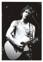 Bob Weir, with an acoustic guitar