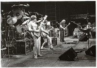 Grateful Dead: Phil Lesh, Bob Weir, Jerry Garcia, Brent Mydland, with Bill Kreutzmann and Mickey Hart obscured