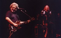 Grateful Dead, ca. 1993: Jerry Garcia, with Vince Welnick in the background