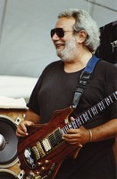Jerry Garcia, with his guitar, Rosebud