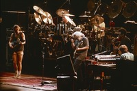 "Grateful Dead: Bob Weir, Bill Kreutzmann, Jerry Garcia, Mickey Hart (obscured), Brent Mydland, and Clarence Clemmons performing ""Morning Dew"""