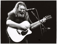 Jerry Garcia playing acoustic guitar