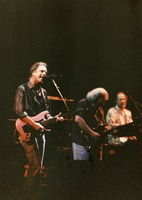 Grateful Dead: Bob Weir, Jerry Garcia and Vince Welnick on stage, ca. 1990