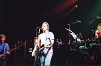 Grateful Dead: Bob Weir, with Phil Lesh and Bill Kreutzmann in the background