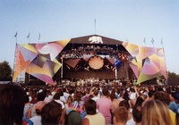 Grateful Dead at Cal Expo Amphitheatre, ca. 1990: distant view of the stage, from the back of the audience