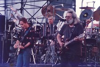 Grateful Dead: Bob Weir, Bill Kreutzmann, and Jerry Garcia, with Mickey Hart, obscured