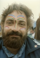 Deadhead with a Grateful Dead-themed rainbow face painting, ca. 1980s