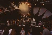 Grateful Dead, ca. 1990s: Phil Lesh, Bob Weir, Bill Kreutzmann, Mickey Hart, Jerry Garcia, Vince Welnick, with Dennis McNally and unidentified crew member below