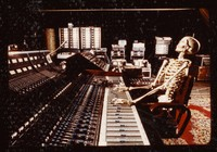 "Skeleton at a soundboard (image used in ""Playing In The Band"", by David Gans and Peter Simon)"