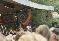 Unidentified band playing at a gathering of Deadheads, ca. 1990