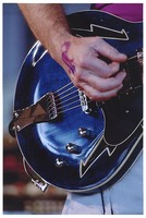 Bob Weir, performing with The Dead: close-up of his hand