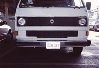 "Deadhead vehicle with ""US BLUS 2"" Illinois license plate, ca. 1990"
