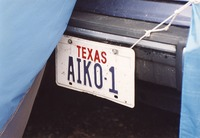 "Deadhead vehicle with ""AIKO-1"" Texas license plate, ca. 1990"