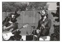 Grateful Dead: Jerry Garcia and Bob Weir with Bill Kreutzmann in the background