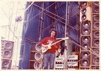 Jerry Garcia in front of the Wall of Sound