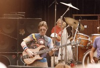 Phil Lesh, with unidentified people in the background