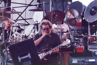 Grateful Dead: Jerry Garcia, with Bill Kreutzmann in the background and Mickey Hart, obscured