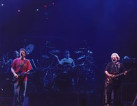 Grateful Dead, ca. 1992: Bob Weir and Jerry Garcia, with Bill Kreutzmann and Mickey Hart in the background