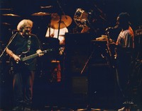 "Grateful Dead and Branford Marsalis: Jerry Garcia and Branford Marsalis, with Mickey Hart in the background, performing ""Bertha"""