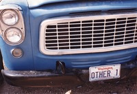 "Deadhead vehicle with ""OTHER 1"" Washington license plate, ca. 1990"