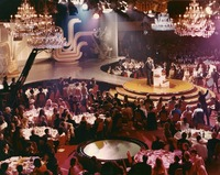 John Wayne and Andy Williams at the podium on the Hollywood Palladium stage during the Academy Awards, ca. 1960s