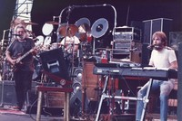 Grateful Dead: Jerry Garcia and Brent Mydland, with Mickey Hart, obscured