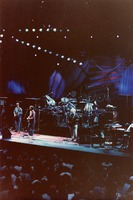 Grateful Dead, ca. 1988: Phil Lesh, Bill Kreutzmann (obscured), Bob Weir, Mickey Hart (obscured), Jerry Garcia, Brent Mydland