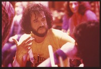 "Airto Moreira, with Flora Purim in the background, perhaps at a recording session for ""Dafos"", ca. 1982"