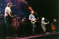 Grateful Dead: Phil Lesh, Bob Weir, Jerry Garcia, and Vince Welnick, with Mickey Hart in background