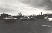 "Scranton promotional package, ca. 1970s: ""Nine: An overcast day's view of the armory's small parking lot. A view looking north into Scranton's Blue or West Mountains."""