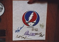 "Grateful Dead merchandise: pellon signed by Jerry Garcia, Mickey Hart, Bill Kreutzmann, Brent Mydland, Phil Lesh, and Bob Weir members, with the ""Steal Your Face"" logo designed by Owsley Stanley and Bob Thomas, that was part of a display at an unknown location"