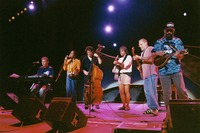 "Bruce Hornsby, Sherri Jackson, Rob Wasserman, Bob Weir, Jorma Kaukonen, and Michael Falzarano performing ""She Belongs To Me"" during the acoustic jam"